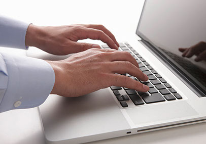 image of hands on laptop computer Via-i Consulting